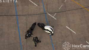 Lifting aerial video of Will walking towards the Saietta R