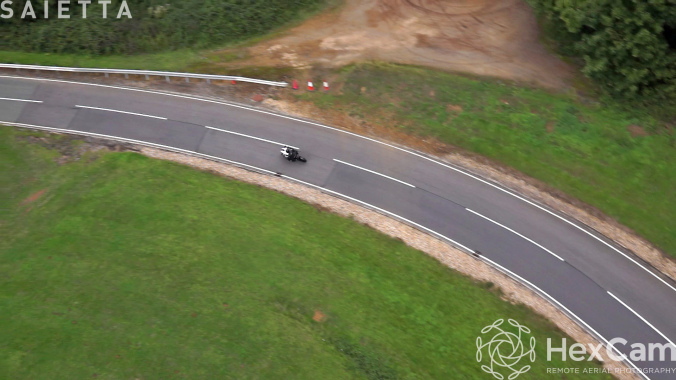 High level aerial panning video of the Saietta R coming out of a bend