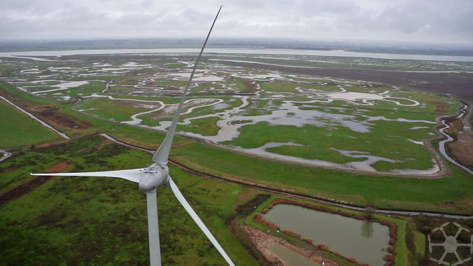 Sheppey wind turbine with marshes and Medway in the background