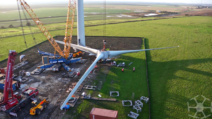 The 40 metre wind turbine blades fixed to the hub and ready to be lifted