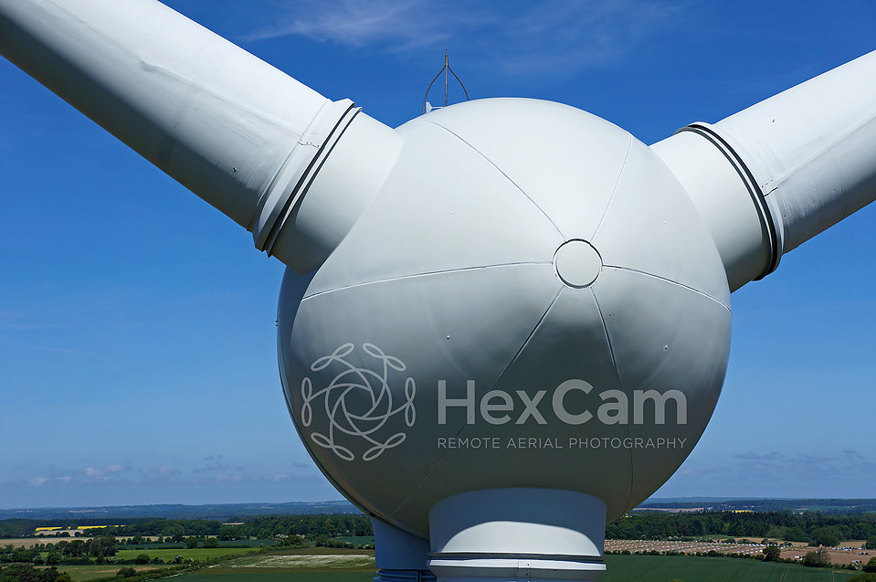 Wind turbine inspection using drones to detect defects.
