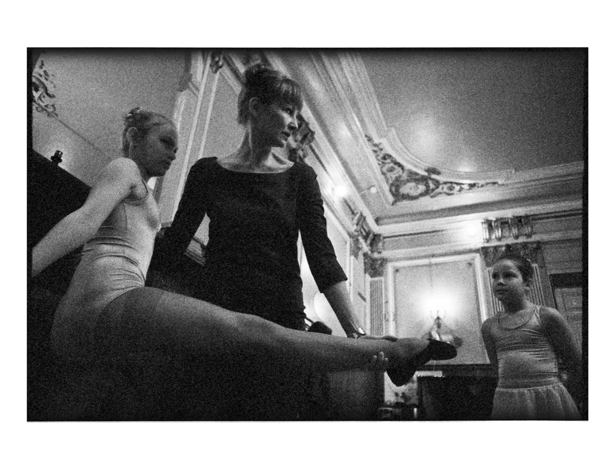 Ekaterina working with two orphans girls, to see how their balletic abilities are.