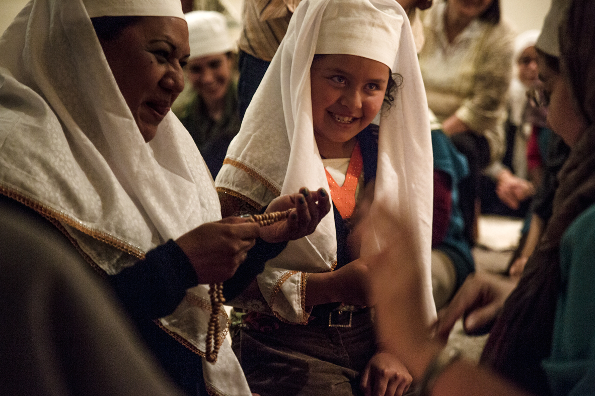 Vivian, a Mexican girl (center) being converted to Islam.