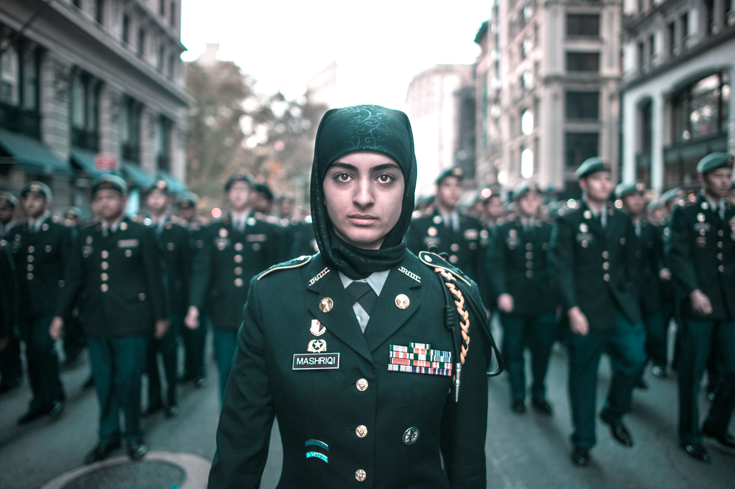 A young Muslim member of the JROTC leads her class down 5th Avenue on Veteran's Day.
