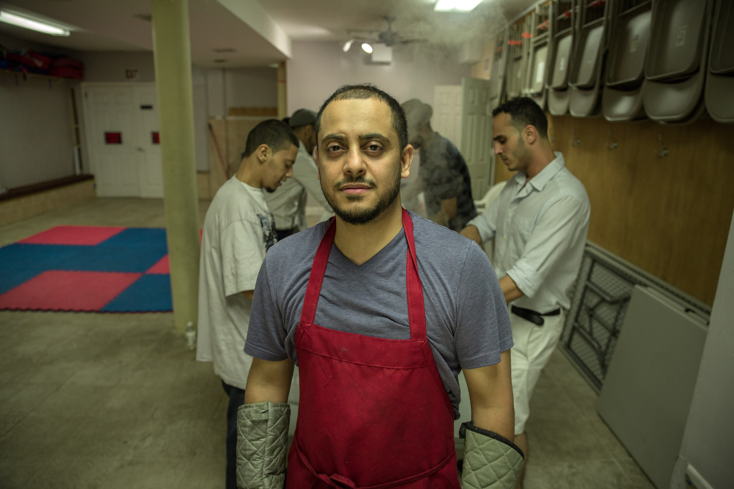 Maeen Ali , a Yemeni Brooklynite, volunteers to cook meals for the homeless. Muslims Giving Back does this every Friday and Saturday night.