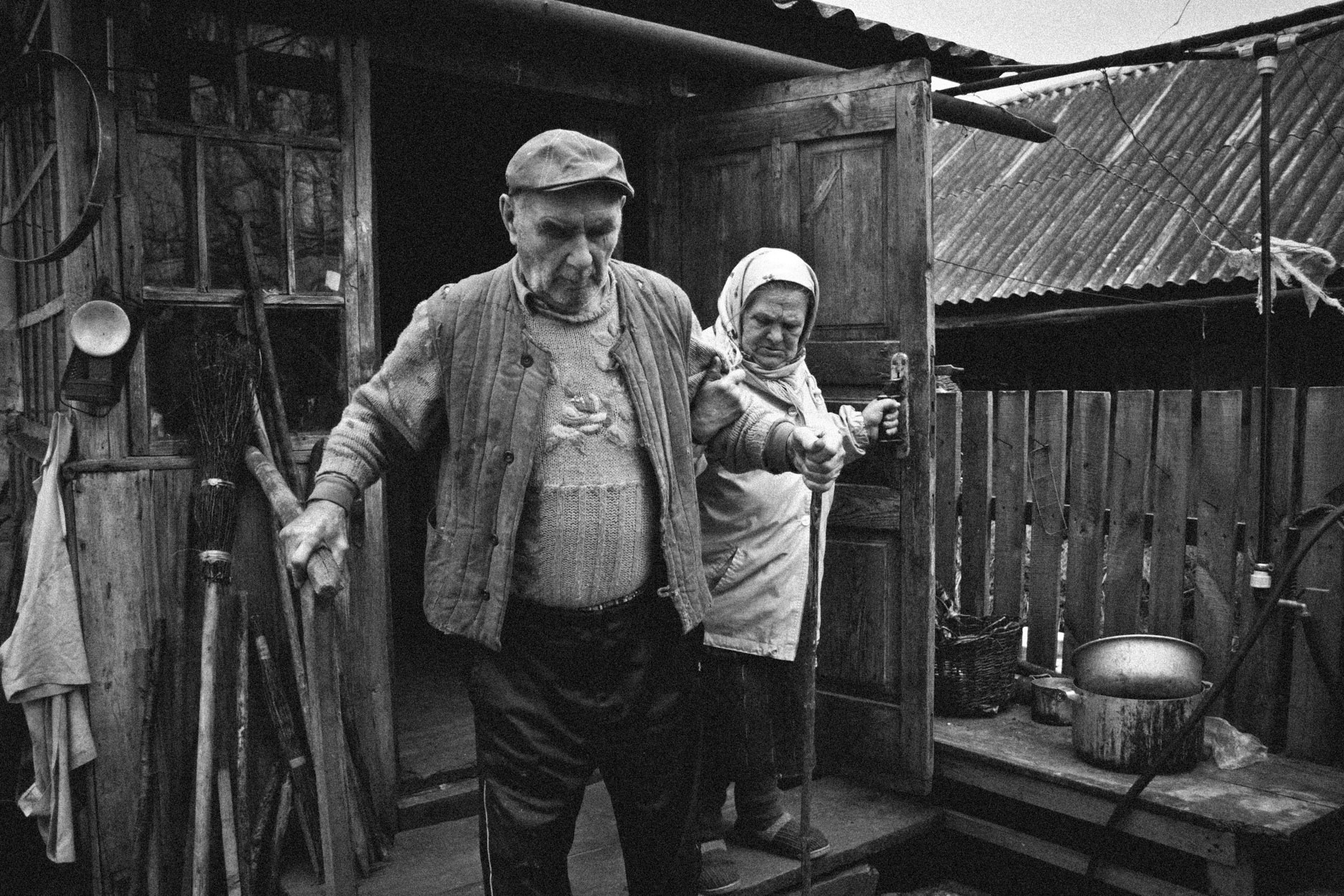 Maria taking Mikhail to the outhouse © Sam Asaert - 2011.jpg