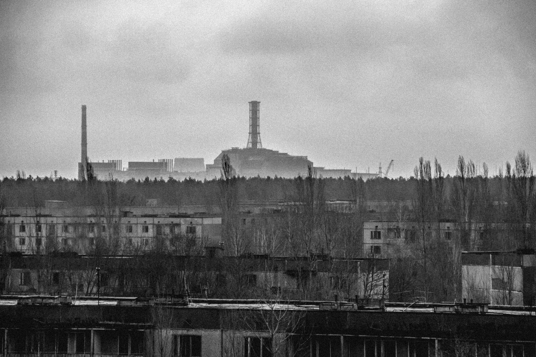 Reactor Four looms over Prypiat © Sam Asaert - 2011.jpg