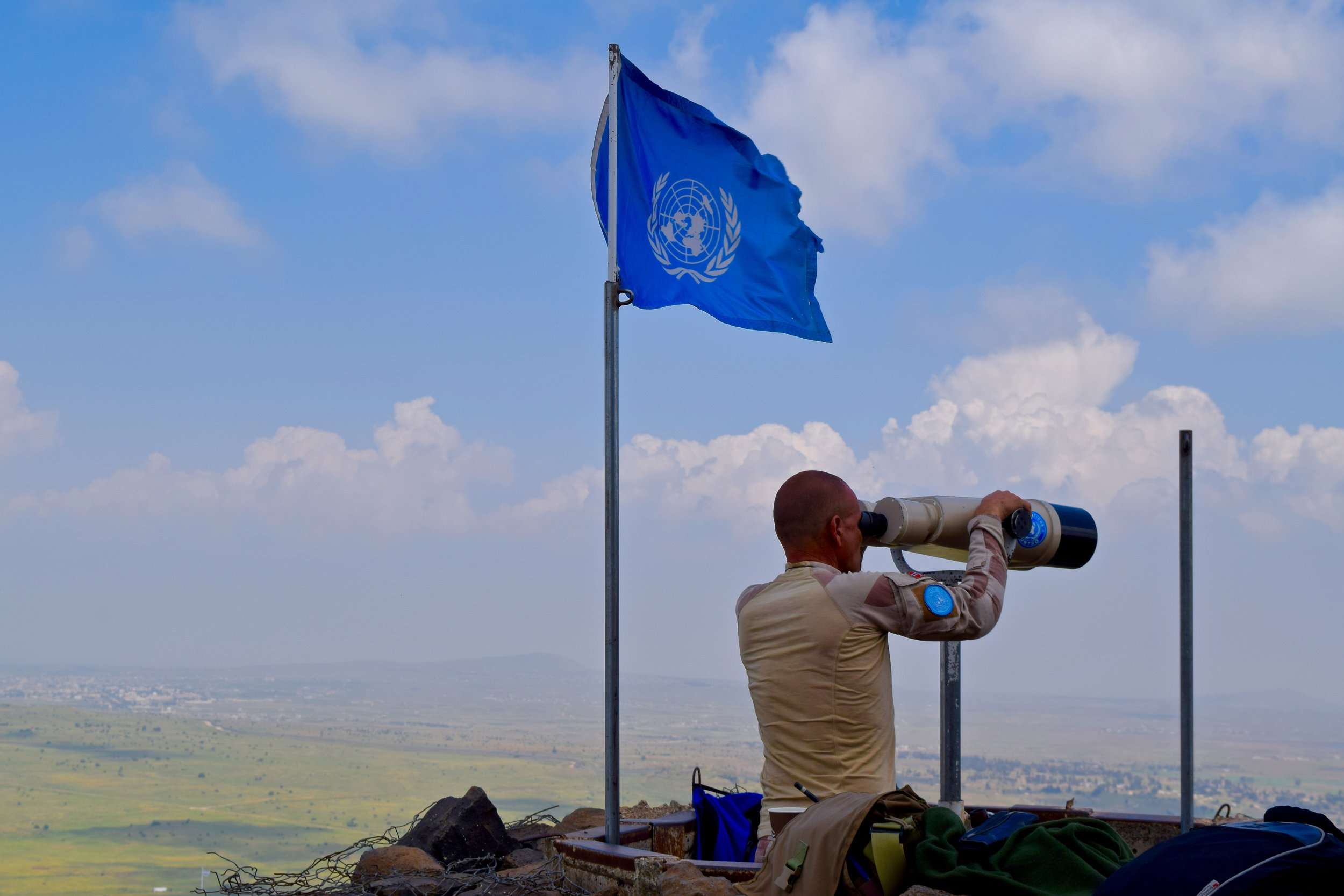 UN peacekeeper monitoring the valley