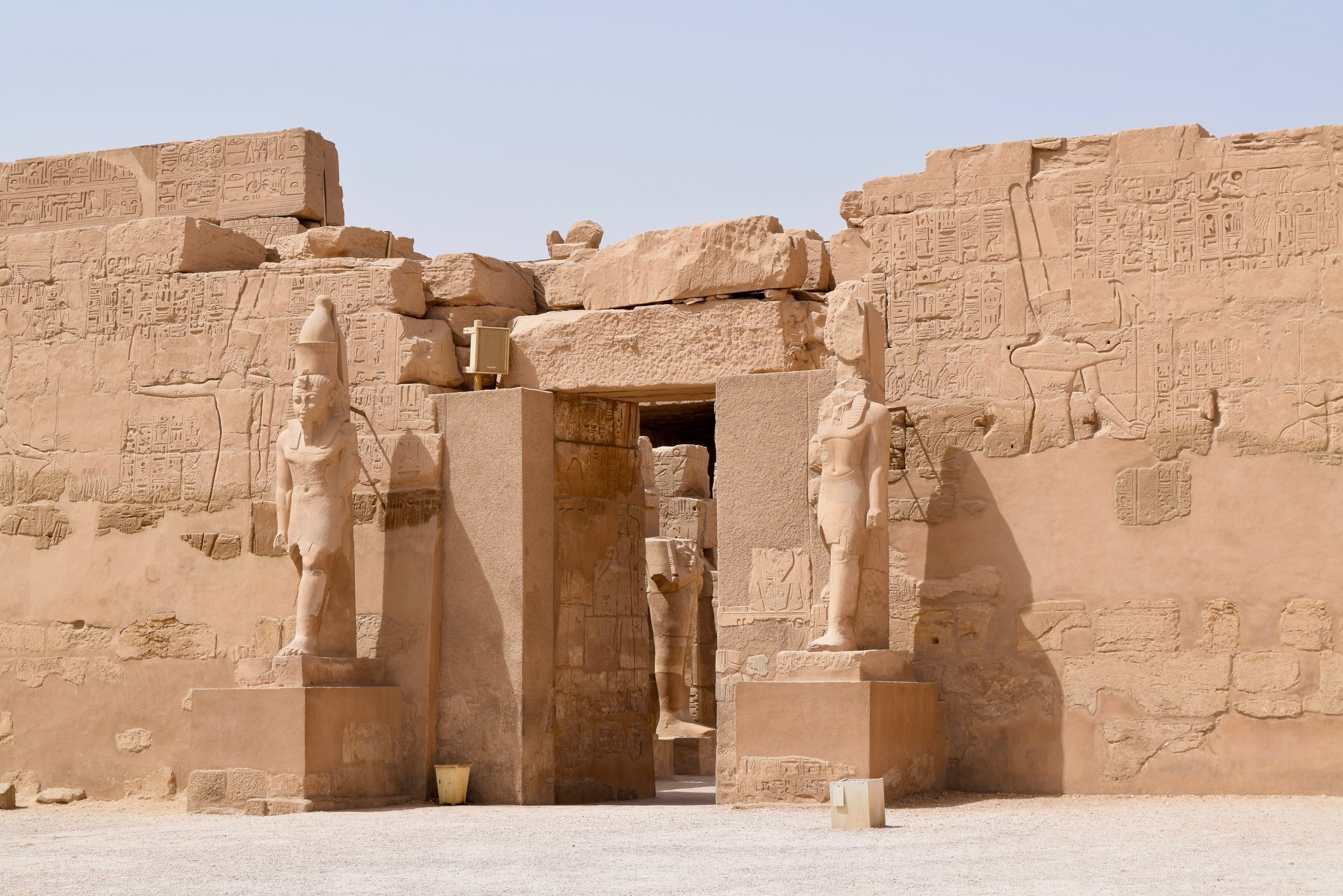 Statues of the Pharaoh on a pedestal