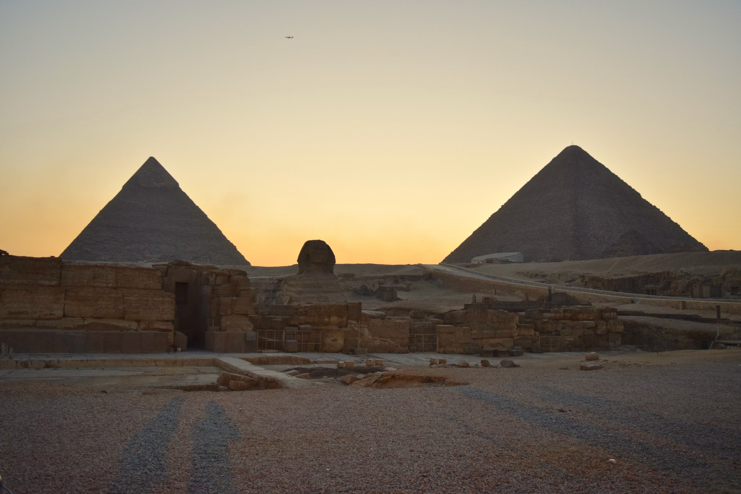 Pyramids and Sphinx of Giza at sunset