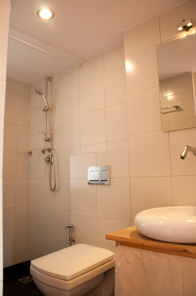 Functional, clean and modern bathroom with hot shower and good pressure.