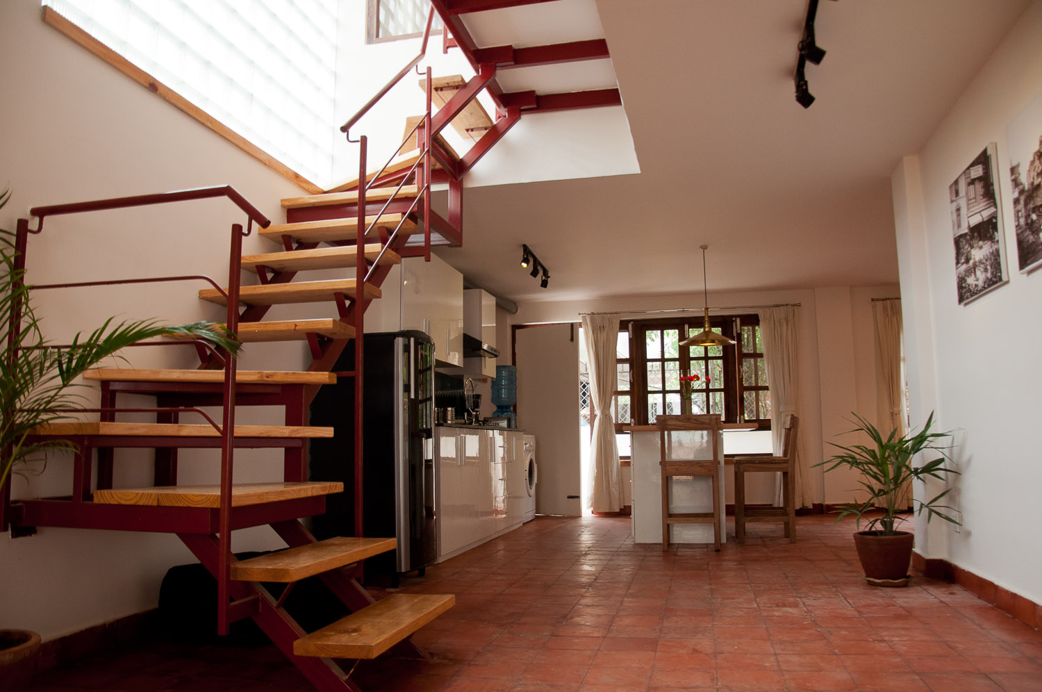 Wooden staircase that leads to the bedroom on 2nd floor.