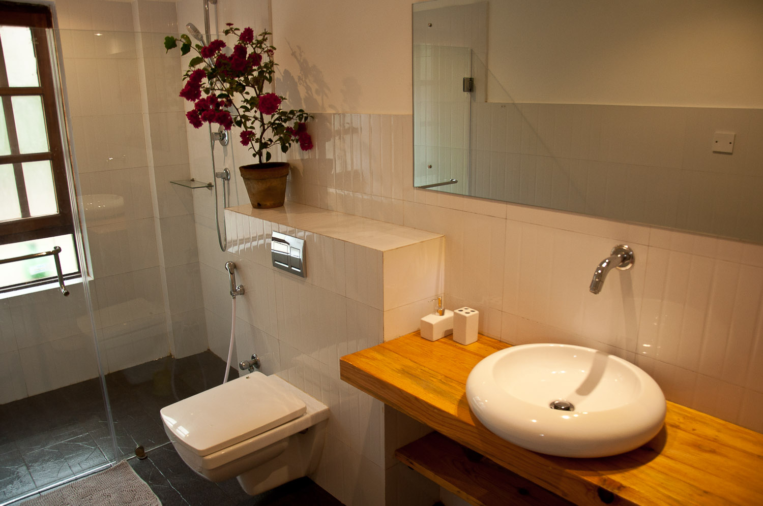 Clean and modern bathroom sink with 24 hours hot water facility.