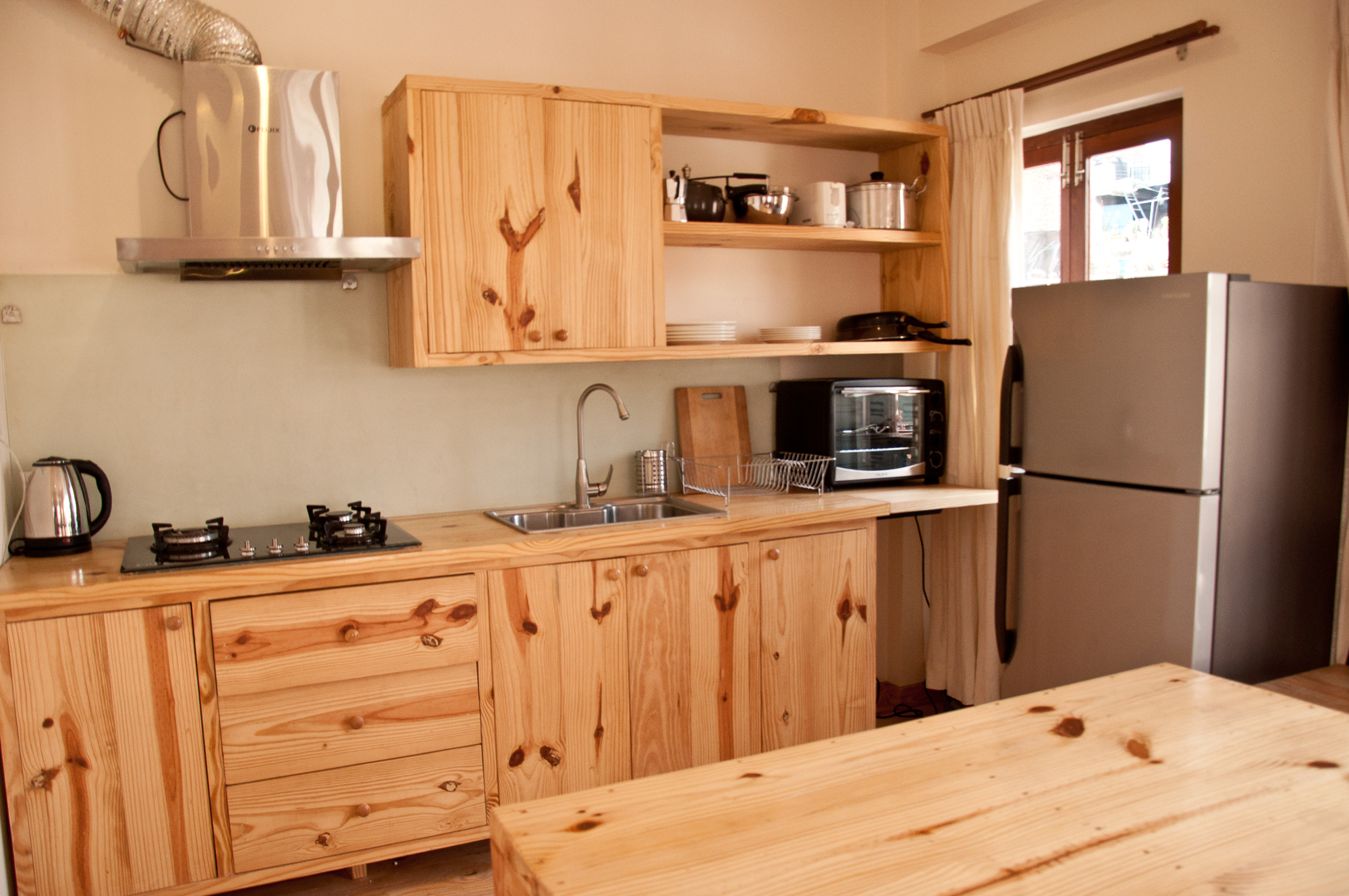 Well equipped Kitchen with oven, pots and pans, fridge , boiler and more.