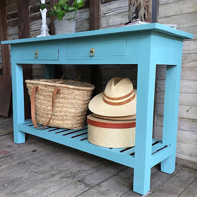 Vintage Console Table hand painted in a striking blue with gold hand pulls on the lower two drawers ...ladder style storage underneath. Perfect for bags, mags, hats or shoes. Link in bio for sale details. #vintageconsole #consoletable #hallwaytable #vintagehomedecor #consoletabledecor