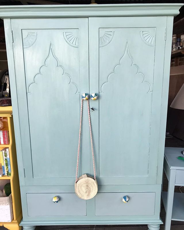 Commission vintage wardrobe completed over the weekend and ready for delivery! This was sourced specifically for the customer and hand painted in a serenity blue #chalkpaint on the outside and a crisp white inside. Featuring beautiful decorative carving on the doors. Finished with blue, white and yellow ceramic hardware. It will sit next to the yellow bookcase in a little girls room.  #vintagewardrobe #vintagehomedecor #vintagekidsroom #serenityblue #shopsmall #comission