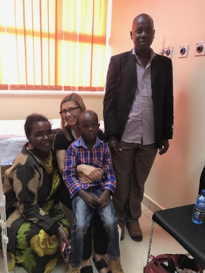 Alexandra Savis from MEAK with Solomon and his family in Nairobi.