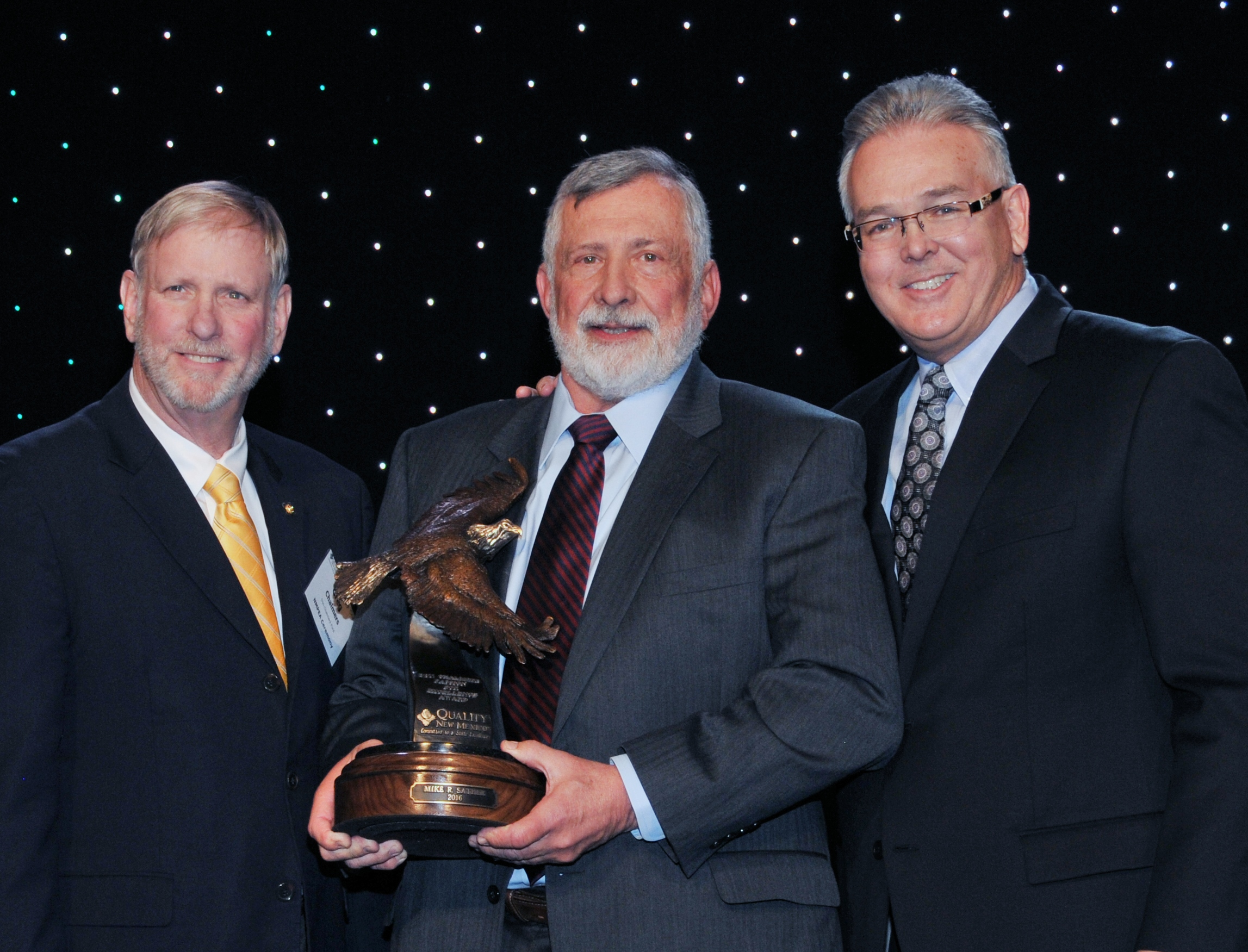 Dr. Mike Sather (photo center) was the first recipient of the award. Greg Chalmers (left) and Steve Keene (right) presented the award at the 2016 Learning Summit.