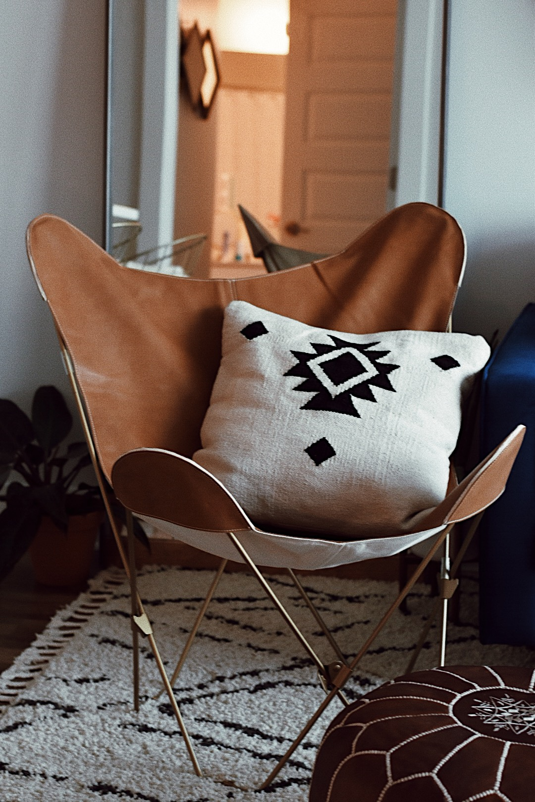 leather foldable butterfly chair urban outfitters.JPG