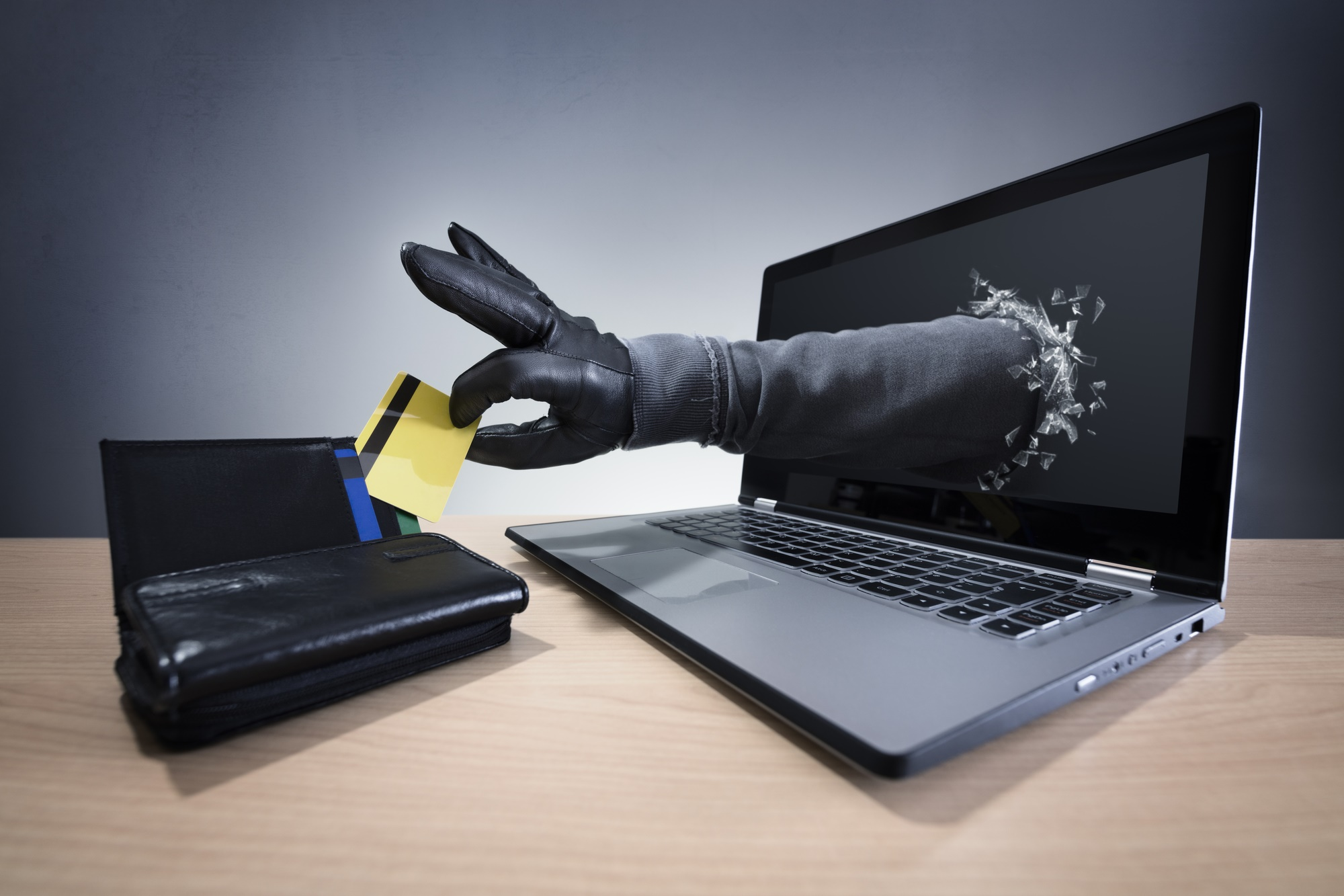 identity theft stealing credit card computer.jpg