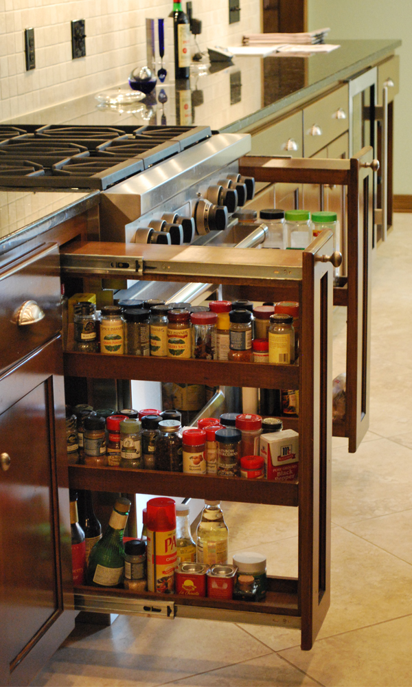 These pull our spice drawers frame the oven and range unit. Their design makes it easy to store and then find specific spices.