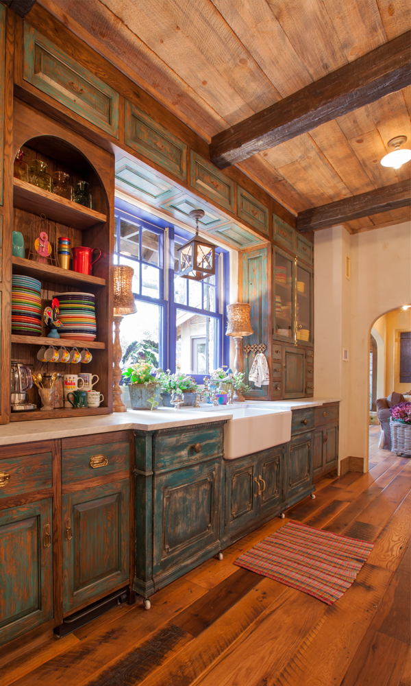 A farmhouse sink is right at home in this rustic country styled kitchen.