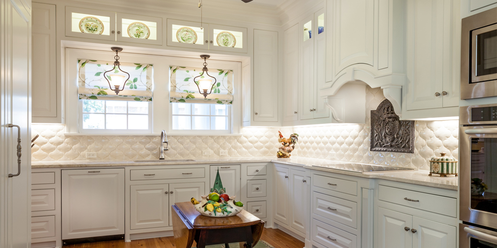 The upper row glass front cabinets in this kitchen allow the homeowners to artfully display some of their special china dishware.