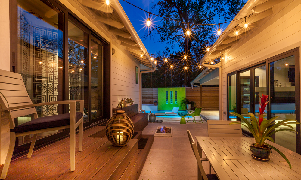 With a small backyard, the homeowners knew they were limited in space for outdoor living. But they made the space between two wings of the house work for a small patio that includes room for quite a bit of seating as well as a built in fire pit.