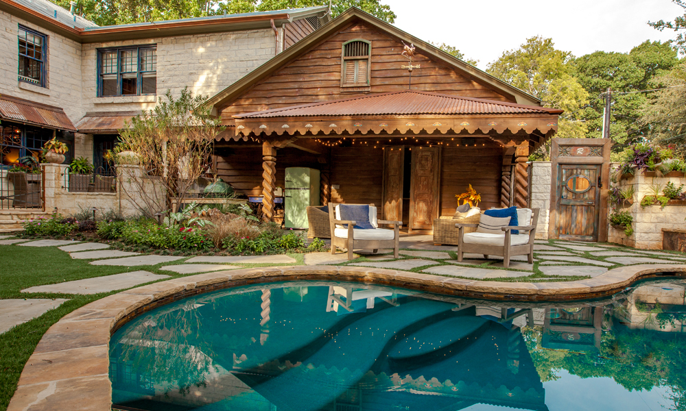 The homeowners strategically chose to open up the third car bay in their garage to create a small covered outdoor patio. While not as extensive as some of our other outdoor living projects, the homeowners invested their budget in creating the specific French country house design that was important to them.