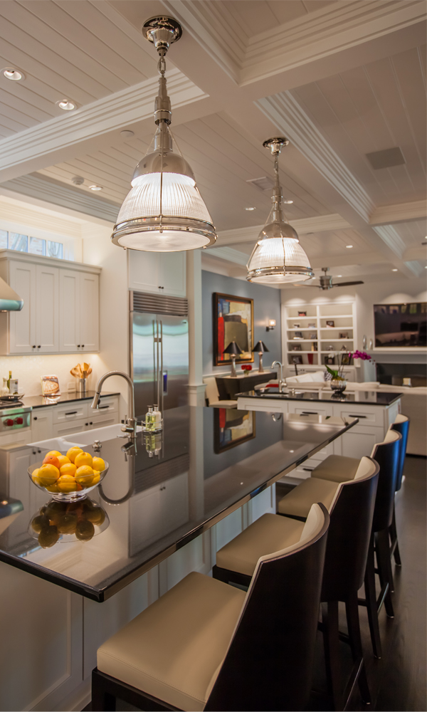 This kitchen incorporates two islands to provide the maximum amount of work space and storage and to help connect the kitchen area to the adjacent living room.