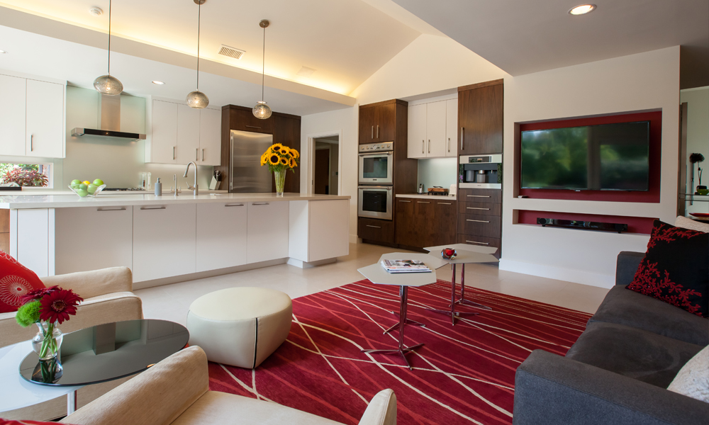 Without any walls separating the kitchen from the adjacent family room the two spaces feel like one room and allow the homeowners and any guests to easily interact between the two rooms.