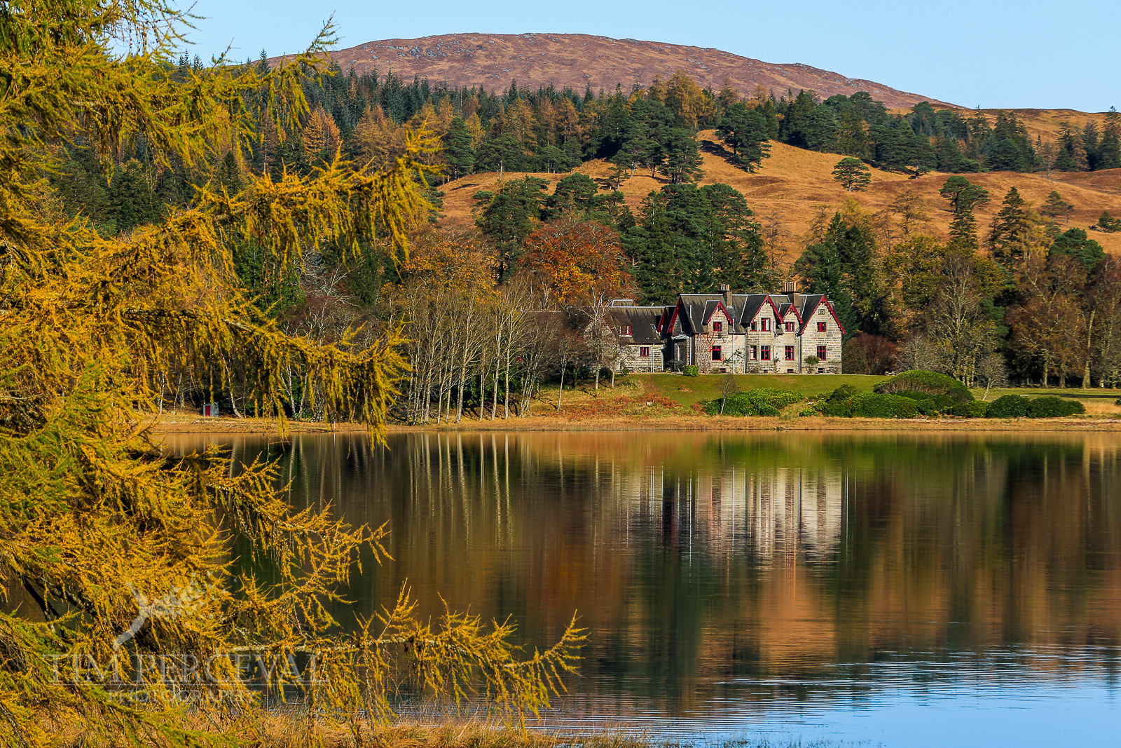 House over the calm of Loch Tulla at Dawn