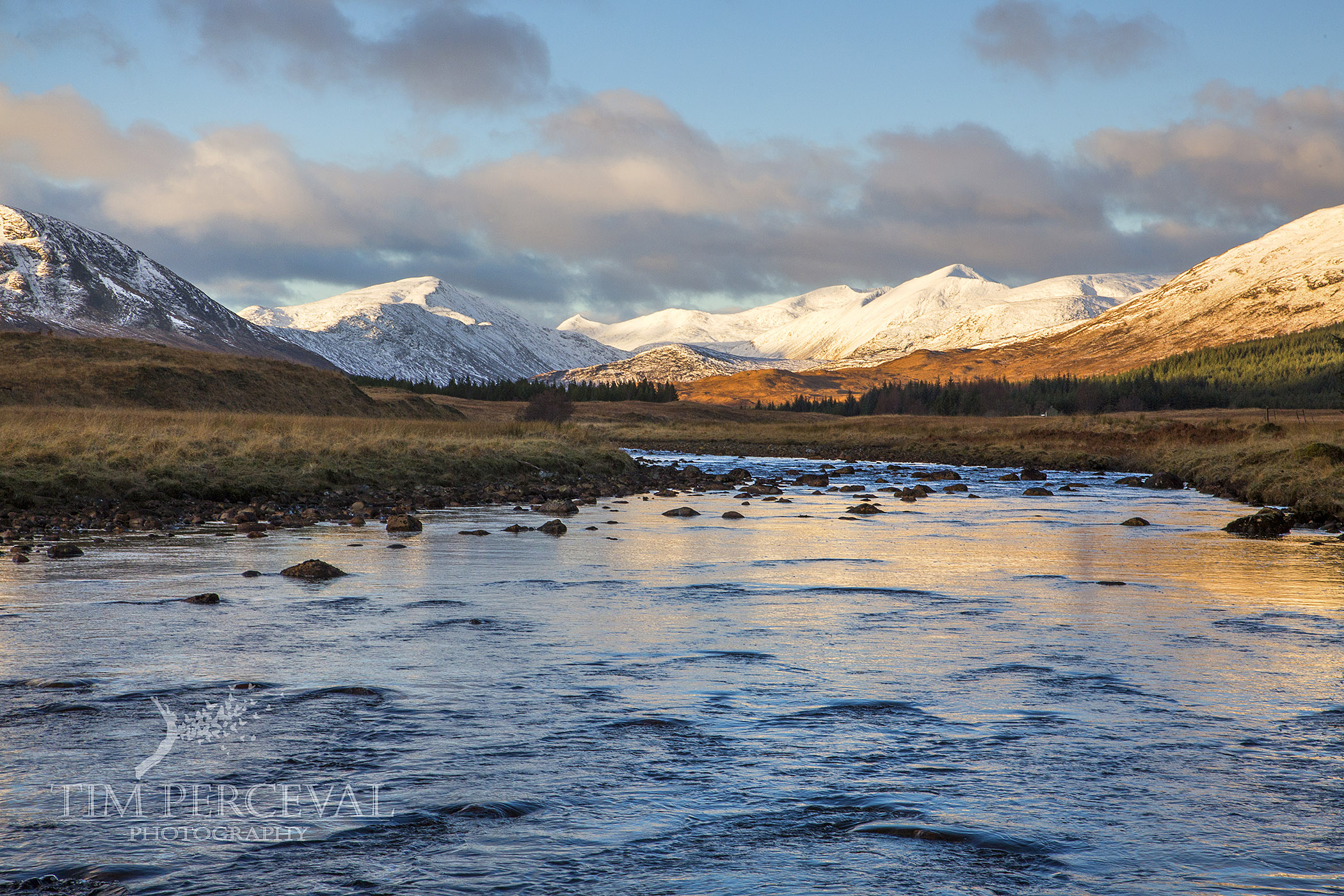 Reflections on Abhain Shira overlooking the mountain range of Stob Ghabhar at Dawn