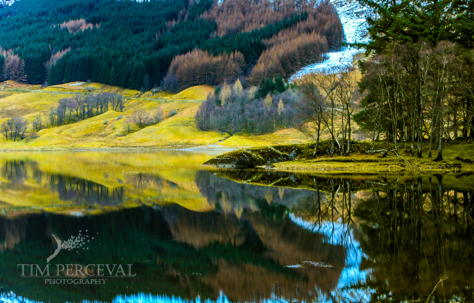 Last of the snow reflection on Loch Lubhair at Dusk
