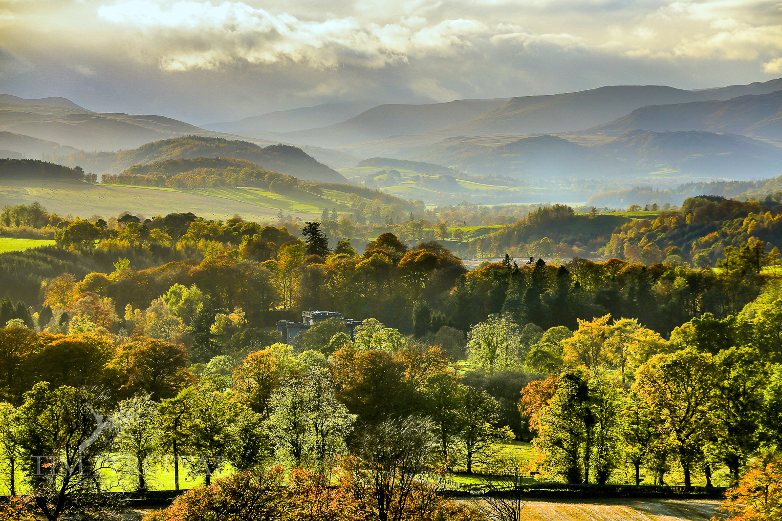 Autumn over the valley of Ochtertyre overlooking Monzie Castle and the hills of Ben Chonzie.