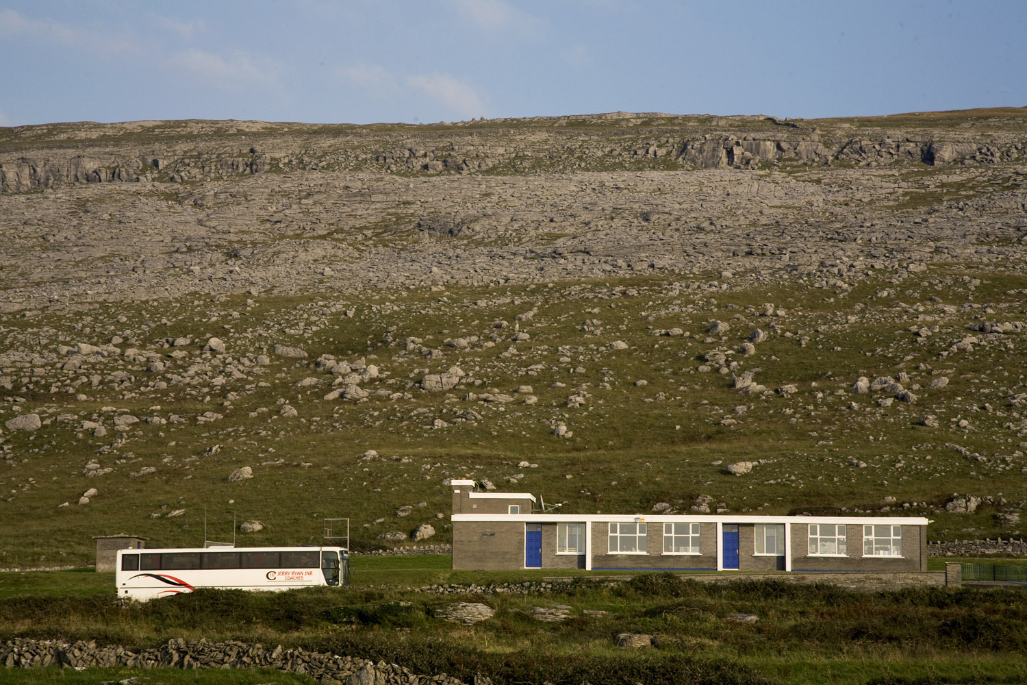 A bus drives through the burren in the west of ireland
