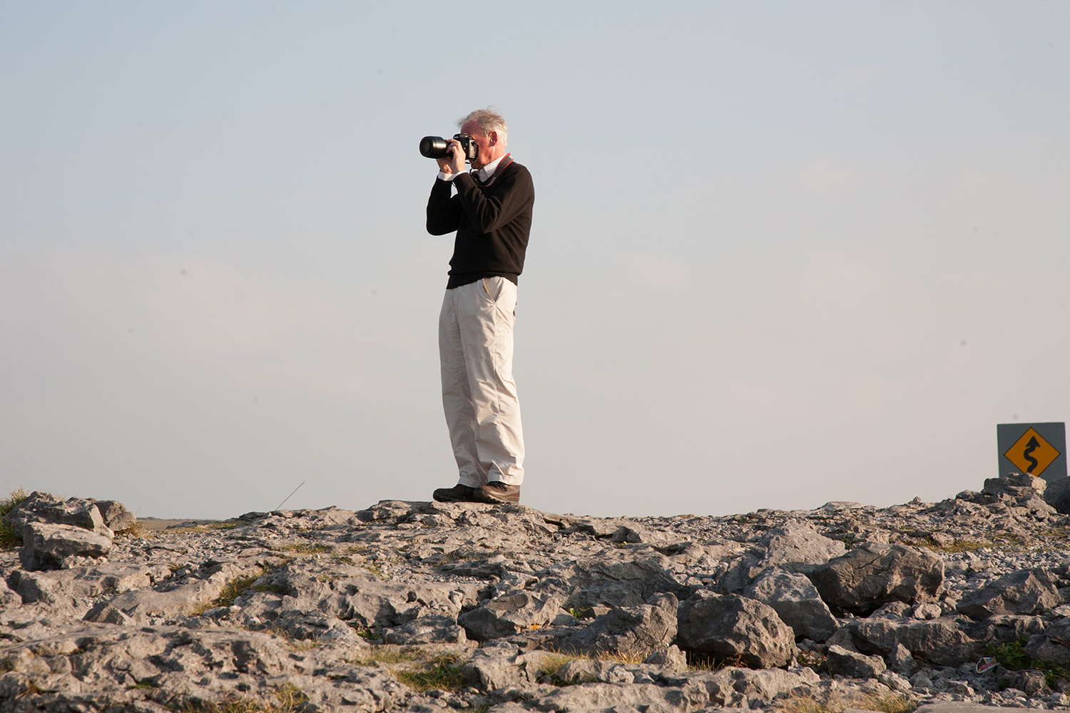 A documentary photograph of a man taking photograph of the Burren in the West of Ireland