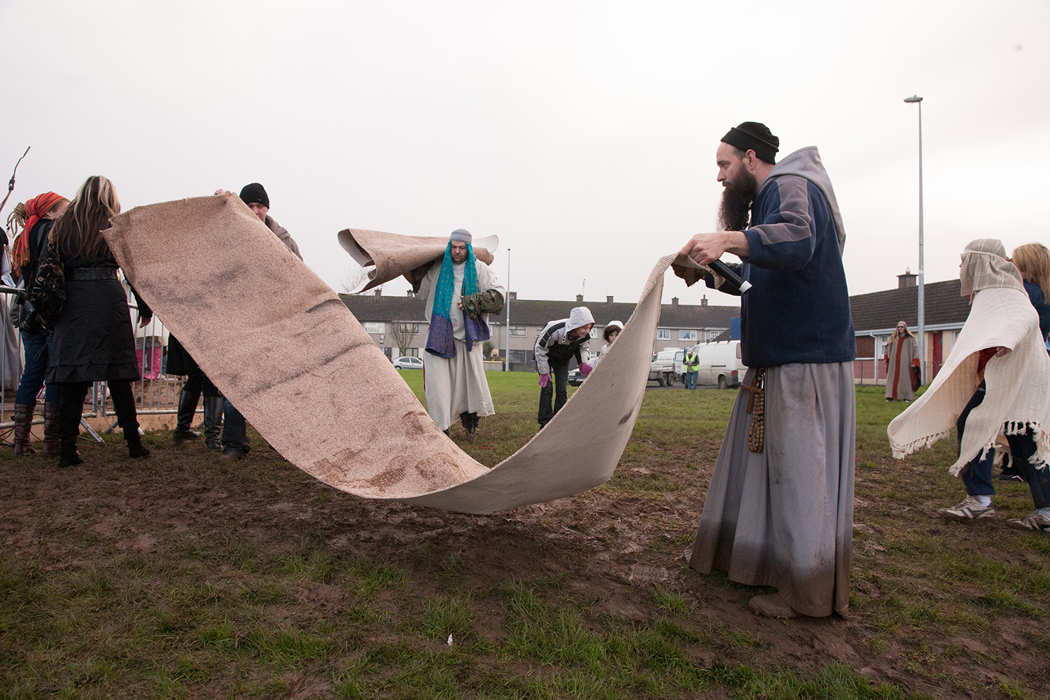 A documentary photograph of monk helping prepare a live nativity scene in Moyross, Limerick, Ireland