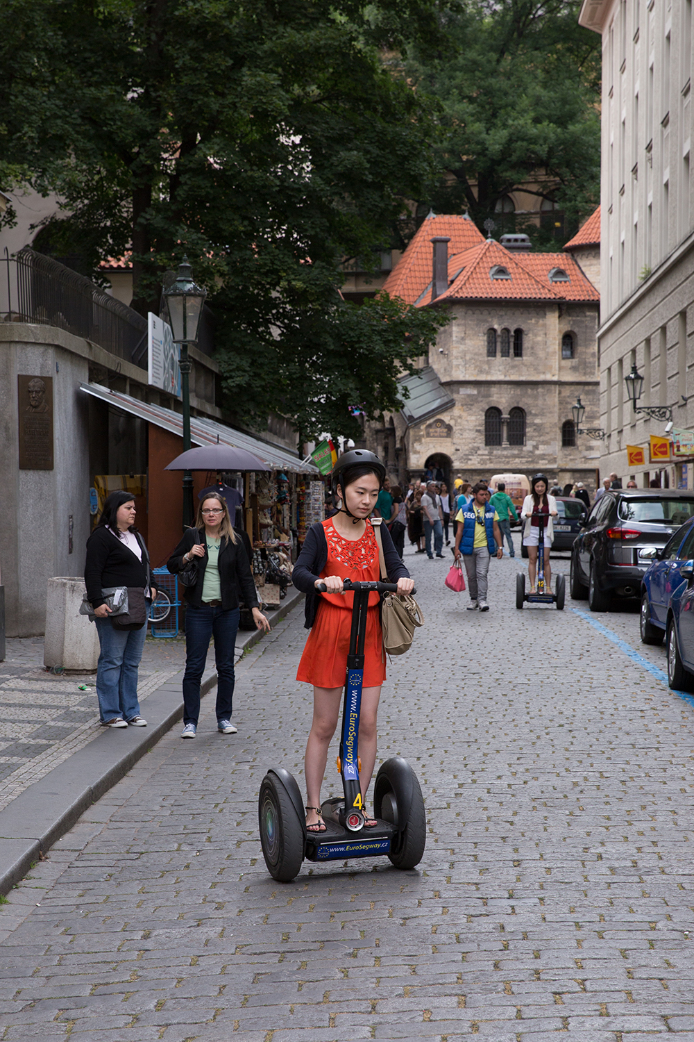 A documentary photograph of a tourist riding a segway around the streets of Prague, Czech Republic