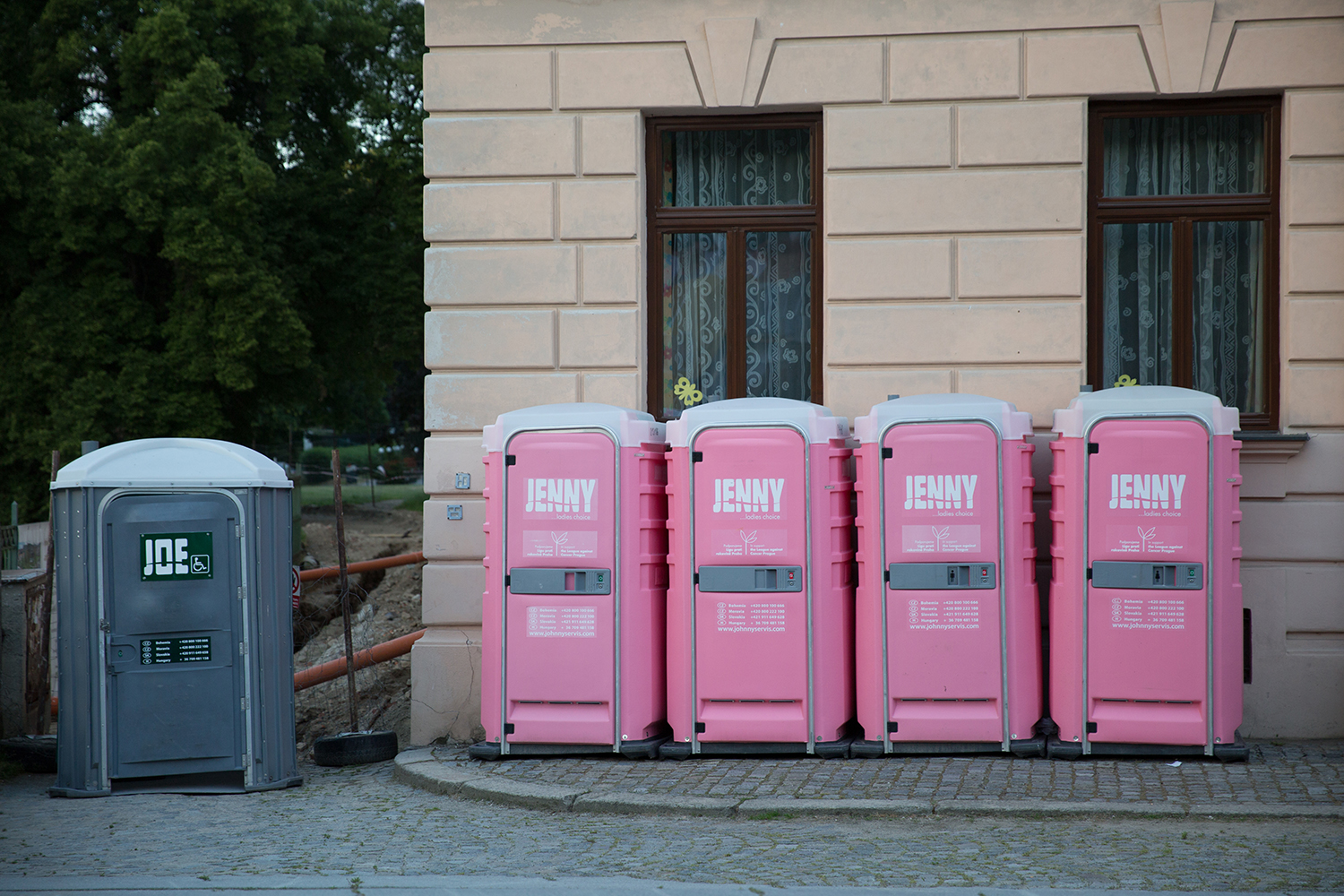 A documentary photograph of men and woman's portable toilets in cesky krumlov, czech republic