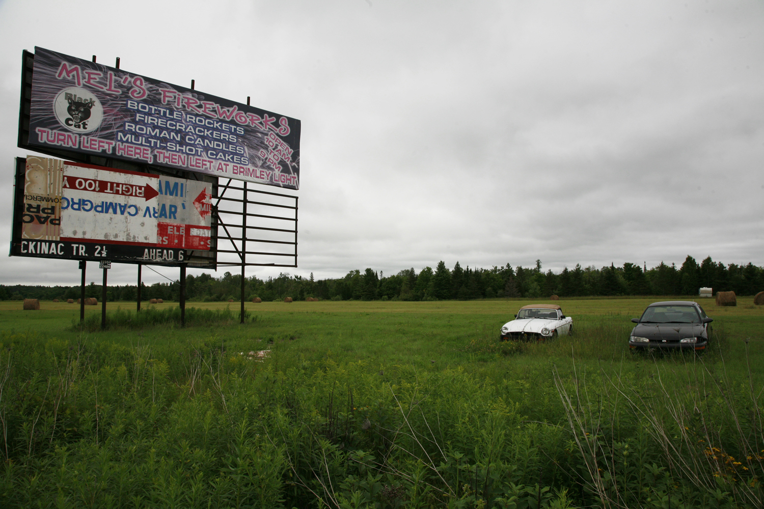 A documentary photograph of a billboard advertising fireworks in the midwest of the united states