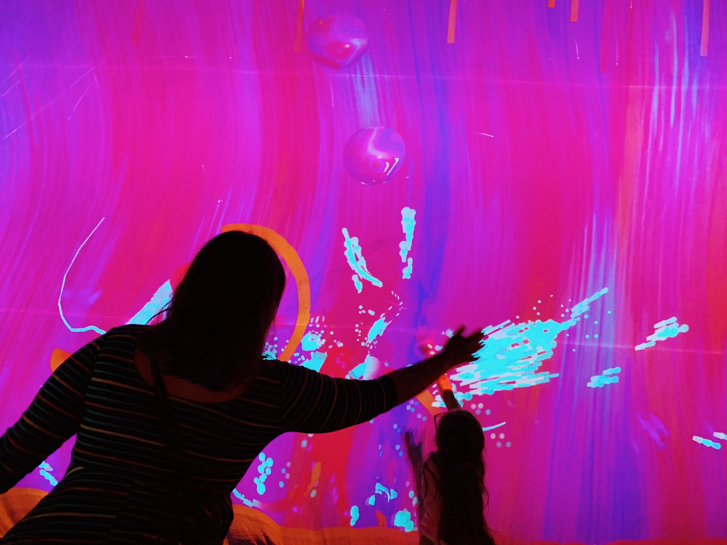 Guests use their bodies to paint digitally on the walls…