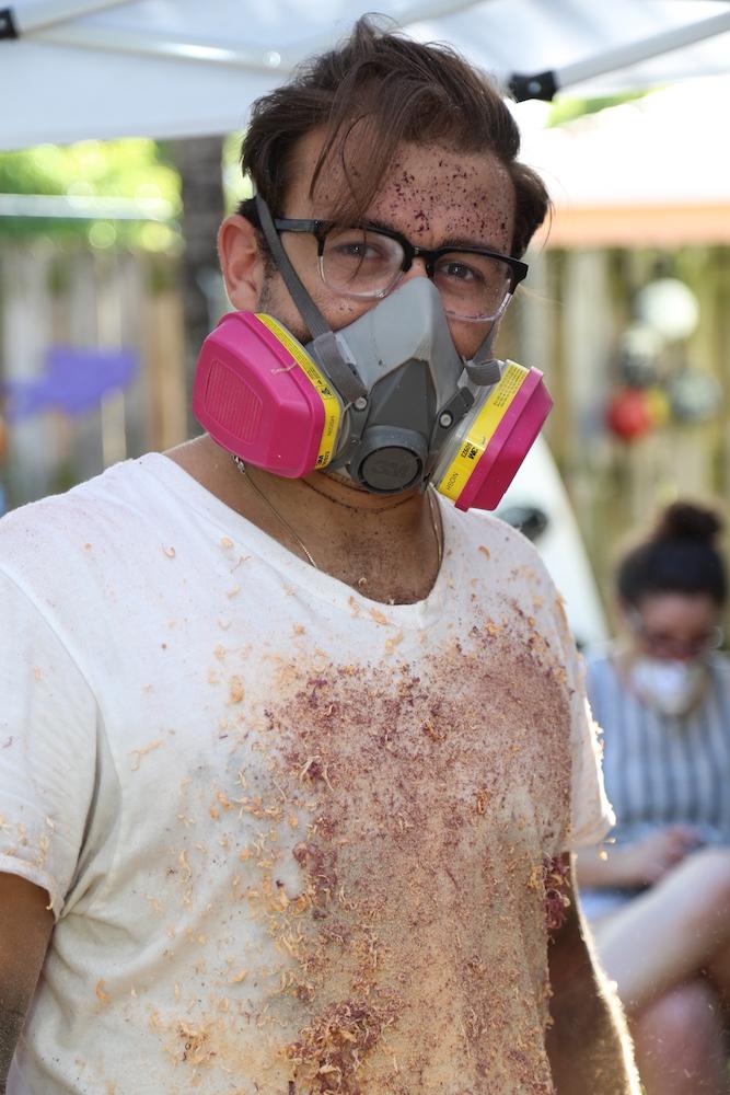 "Bryan Saavedra in his backyard's ""guerrilla wood shop."""