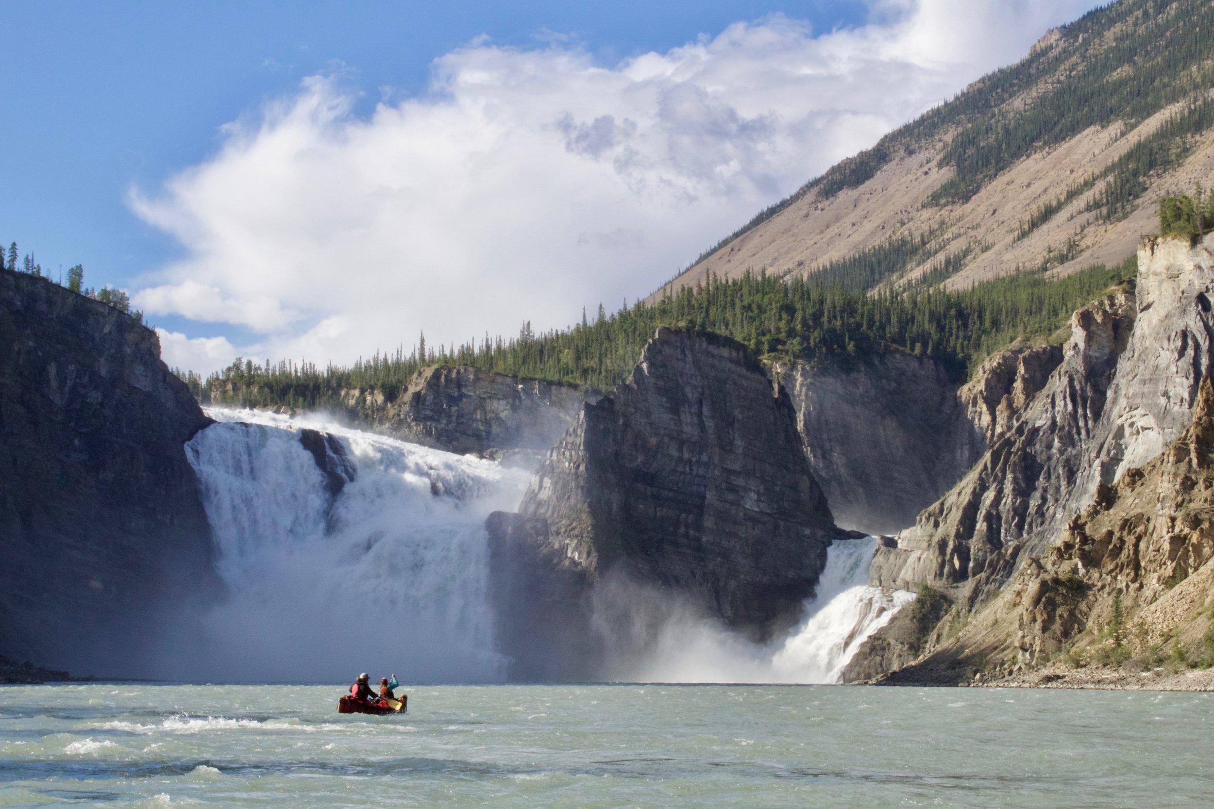 Guide Daniel Robb ferries out below Virginia Falls in a 17' Prospector Canoe.