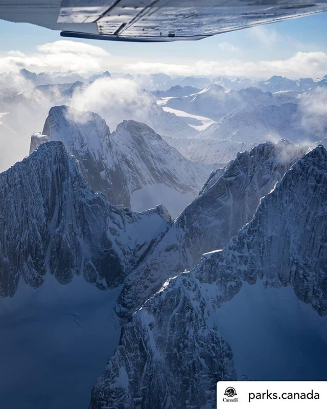 Amazing to see a little light shine on this part of world in the depth of winter. The Ragged Range shows it it tip top in any season. It also poses the question. Who were you flying with @kevinmonahanphoto • @parks.canada Undisturbed by roads or seismic lines, Nahanni National Park Reserve was one of the first parks to be listed as a UNESCO World Heritage site and is globally renowned for its geologic landforms and incomparable northern wilderness. 🌲🗻 📷: @kevinmonahanphoto . . . . . #NahanniNPR #Nahanni #NationalPark #ParksCanada #NorthWestTerritories #NWT #North #mountains #plane #views #travel #ExploreCanada #DiscoverCanada #InstaTravel #Tourist #Wanderlust #winter
