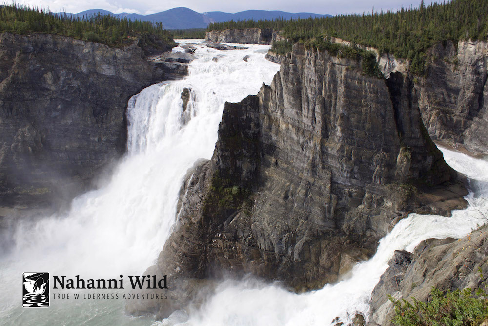 Download     Caption:  Nahanni River thundering through Virginia Falls. A special view which shows the exposed face of Mason Rock, a landmark named after Canadian canoeing icon Bill Mason.   Photographer:  ?   Location:  Virginia Falls, Nahanni National Park (the 1st UNESCO World Heritage Location)