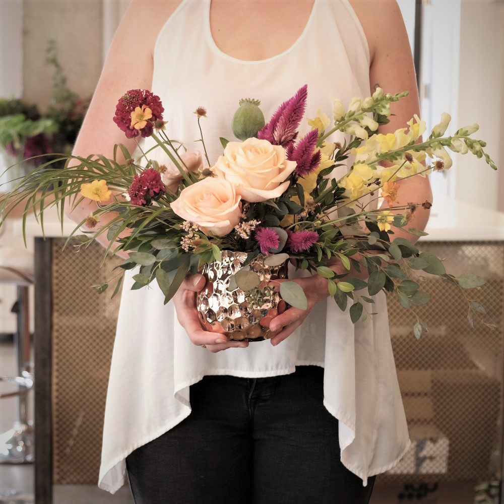 This is a: - Medium Arrangement with aBright and Ornate color inspirationwith a Vase.