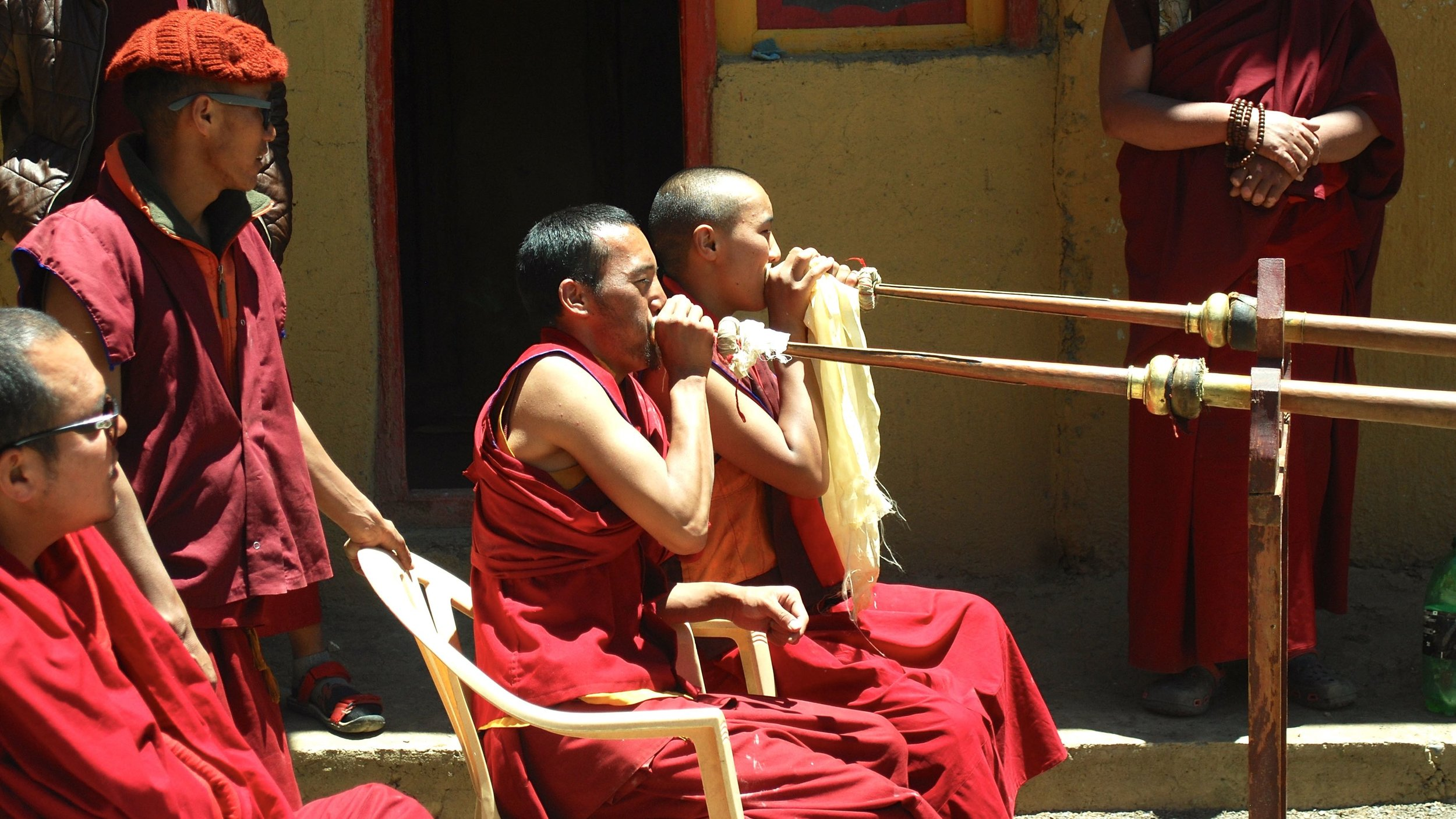 Inda-Spiti-Cham-dance-monks-horns.jpg