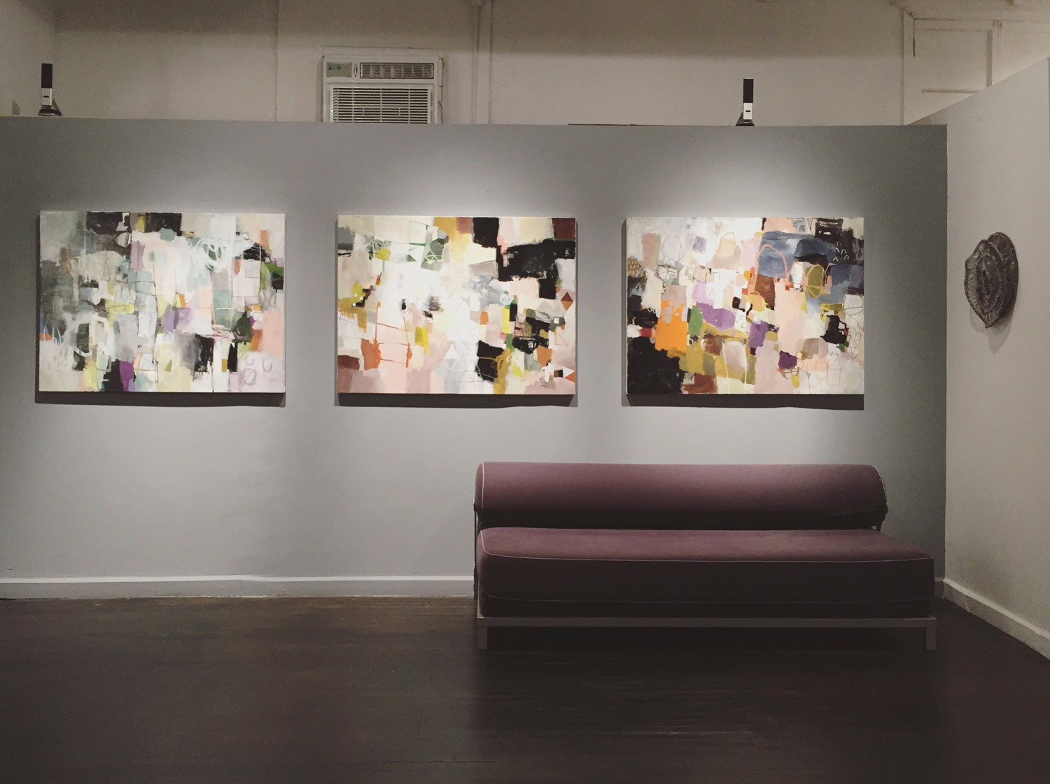 "Painting trio, from left to right, ""Lost in Paradise"", ""Storytelling"", ""Pink Castle"""