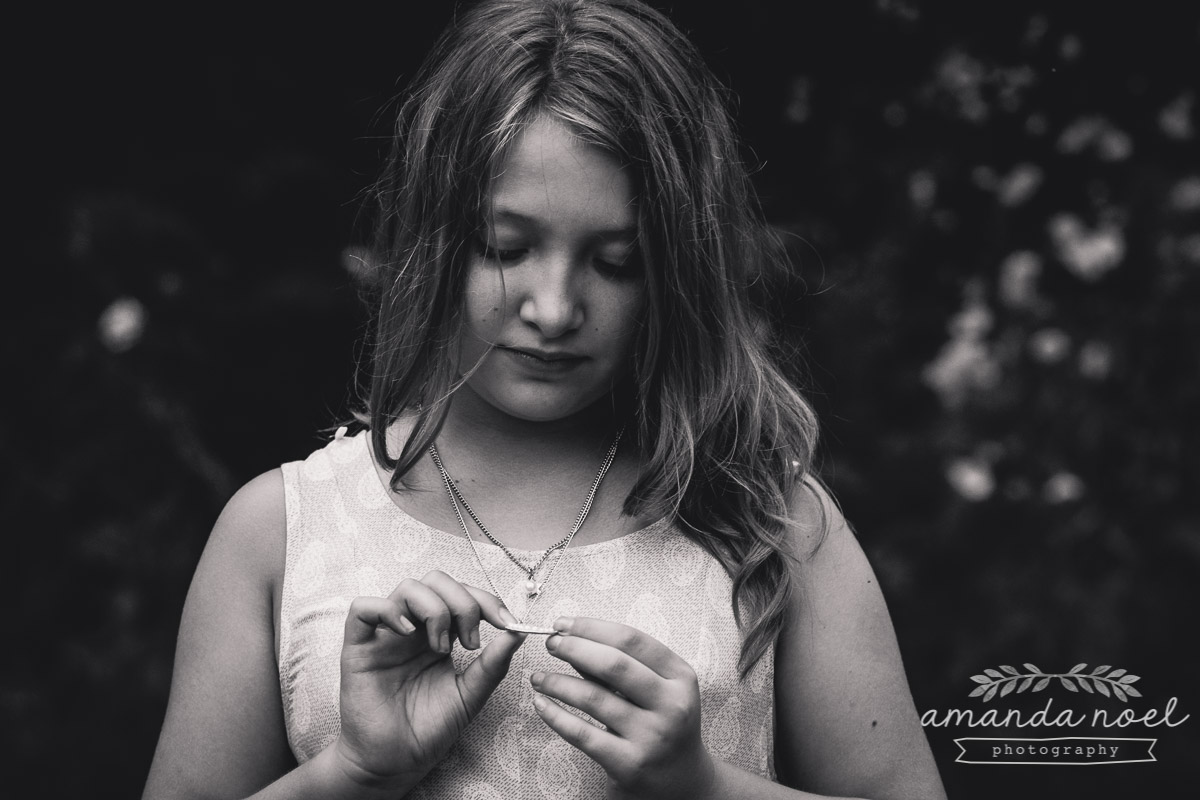 girl-black-and-white-portrait-natural-looking-down